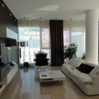 Белый диван и черная мебель в гостиной