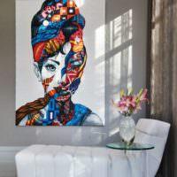 Картина в стиле арт-декора над креслом в гостиной