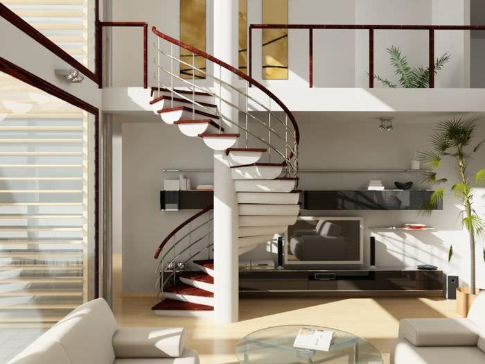 Винтовая лестница с оригинальными ступенями в интерьере жилого помещения