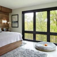 Вид из спальне на природу через панорамное окно