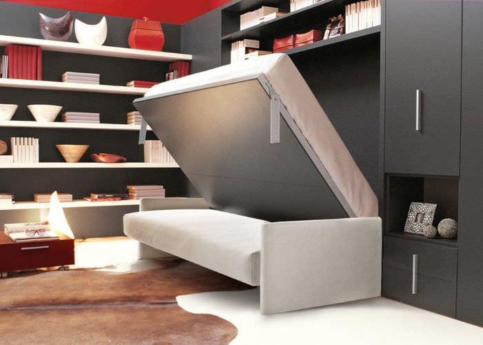 Кровать-диван в интерьере жилища холостого мужчины