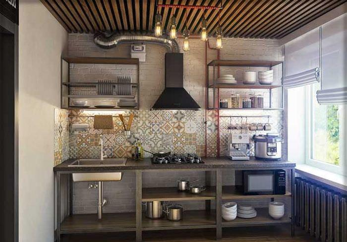 Интерьер кухни однокомнатной квартиры в стиле лофт