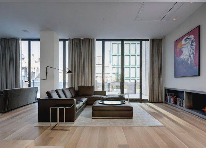 Кожаная мебель в интерьере гостиной комнаты