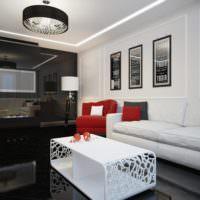 Красный цвет в роли акцента в черно-белой спальне