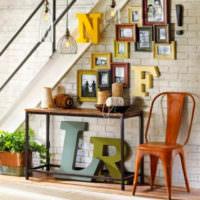 Буквы из дерева под лестницей частного дома
