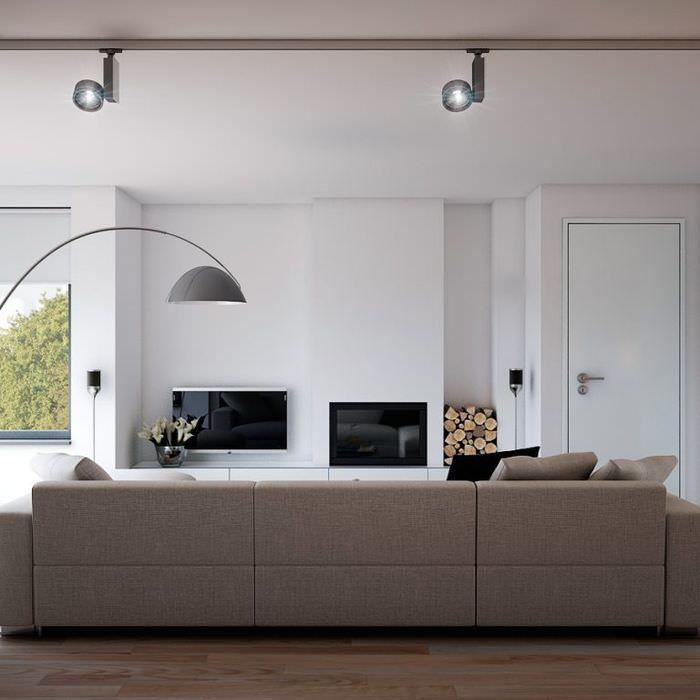 Потолочные софиты с направленным светом в интерьере гостиной