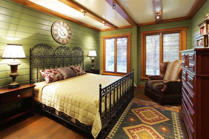 Интерьер спальни в оливковых цветах в сочетании с натуральным цветом дерева