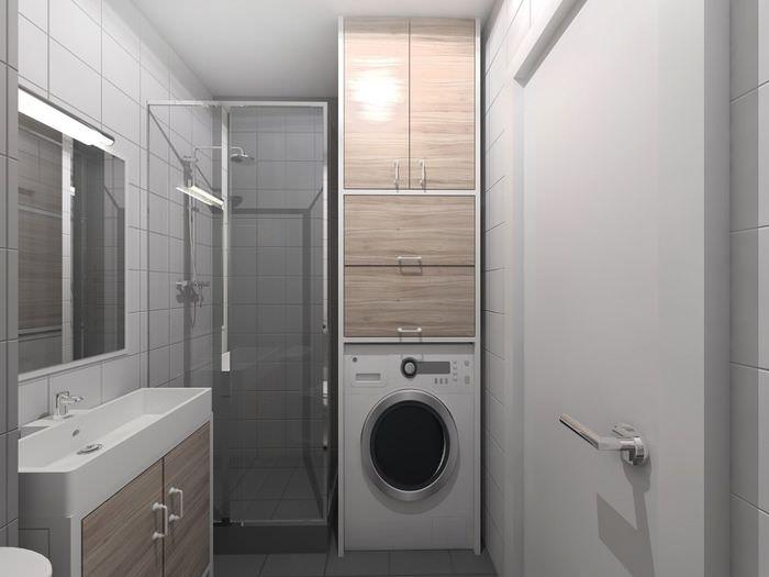 Душевая кабина и стиральная машина в санузле однокомнатной квартиры