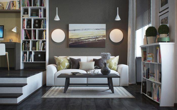 Зонирование подиумом квартиры-студии в серых тонах