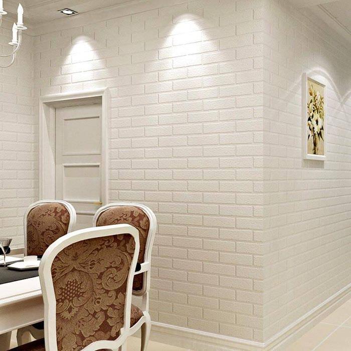 Белая стена с обоями под кирпич в интерьере гостиной