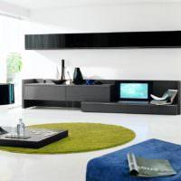 Темная мебель в гостиной стиля минимализма