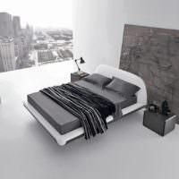 Серый интерьер в гостиной городской квартиры стиля минимализма