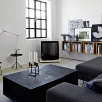 Черная мебель в интерьере белой комнаты