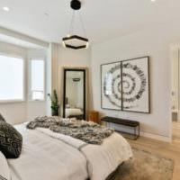Люстра в духе минимализма над кроватью в спальне супругов