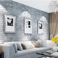 Серый интерьер гостиной с диваном