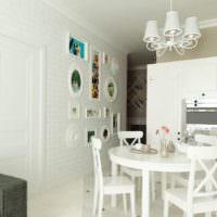 Белая кухня гостиная с кирпичной стеной