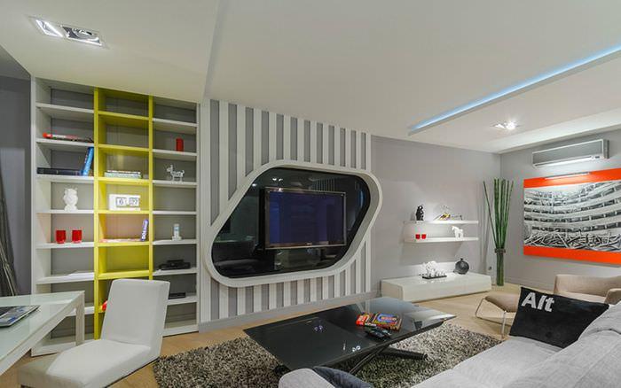 Гостиная в космической стилистике с оригинальной стойкой для телевизора