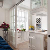 Зонирование кухни-гостиной с помощью перегородки