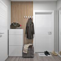Белые двери в светлом коридоре