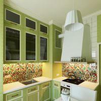 Зеленые дверцы гарнитура с вставками из черного стекла