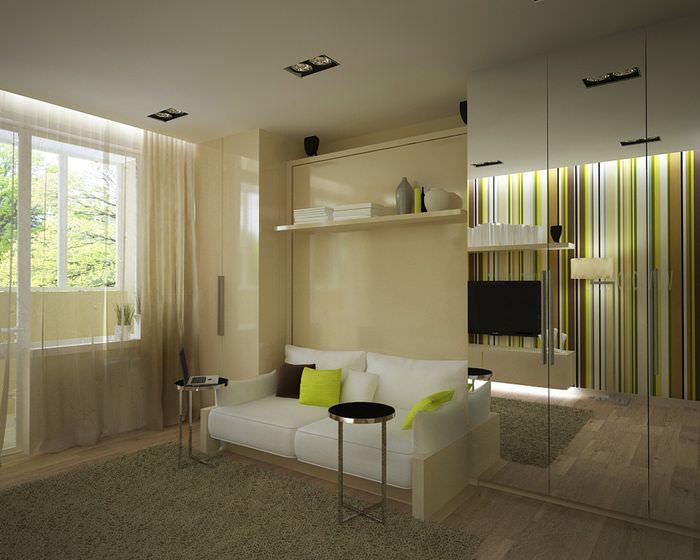 Белый диван в гостиной зоне однокомнатной квартиры