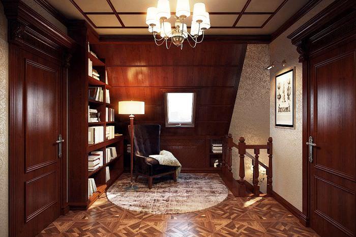 Небольшая библиотек в холле мансардного этажа
