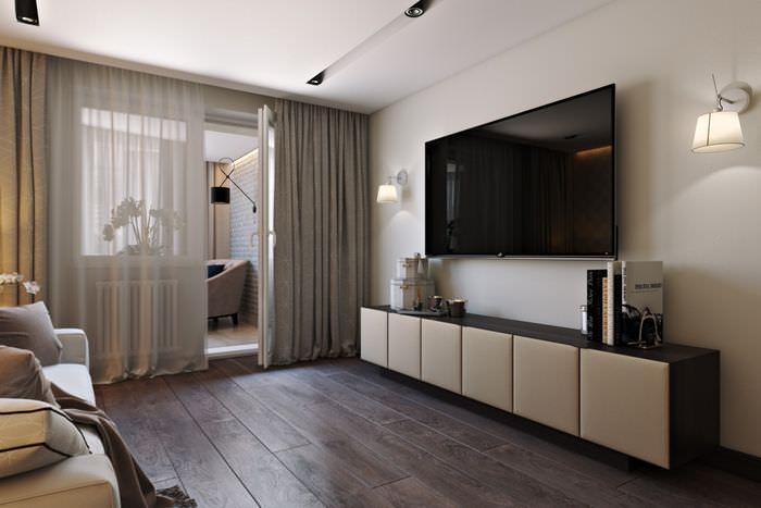 Большой черный телевизор в гостиной с лоджией