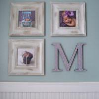 Первая буква имени ребенка на стене детской комнаты