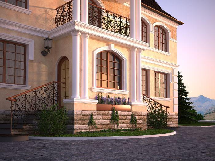 Парадный вход с колоннами и высоким крыльцом