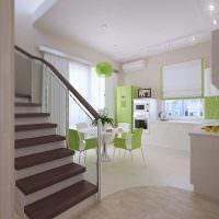 Зеленый холодильник на кухне в пастельных тонах
