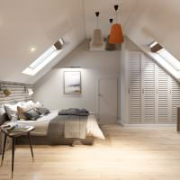 Интерьер спальни в мансардном помещении