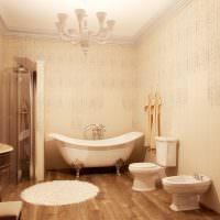 Ламинат на полу просторной ванной комнаты