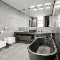 Интерьер ванной с зеркальной стеной