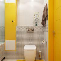 Акценты желтого цвета в современном туалете
