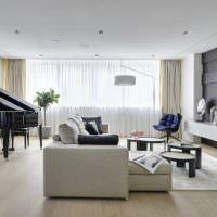 Черный рояль в интерьере гостиной
