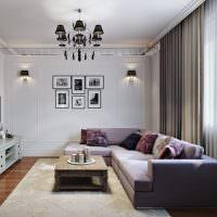 Декорирование стены гостиной с помощью картин