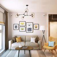Картины в рамках над диваном в жилой комнате