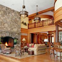 Камень и дерево в оформлении интерьера гостиной