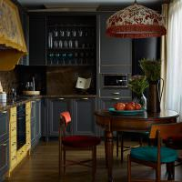 Интерьер современной кухни в темных оттенках