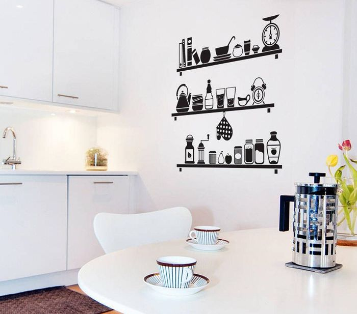 Черные виниловые наклейки на белой стене кухни