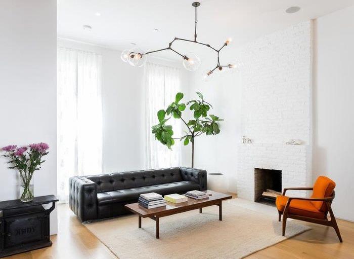 Контрастной сочетание черной мебели с белями стенами