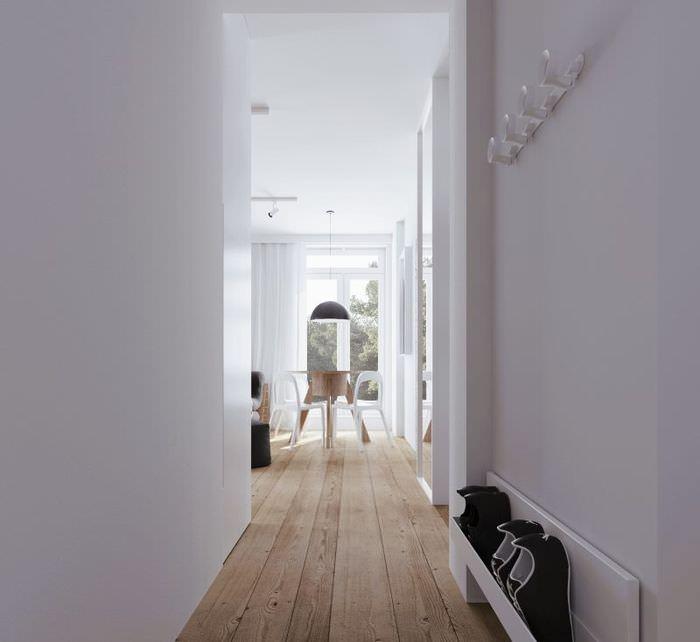 Белые стены узкой прихожей в стиле минимализма