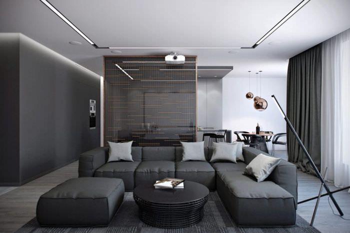 Угловой серый диван в зале стиля хай-тек