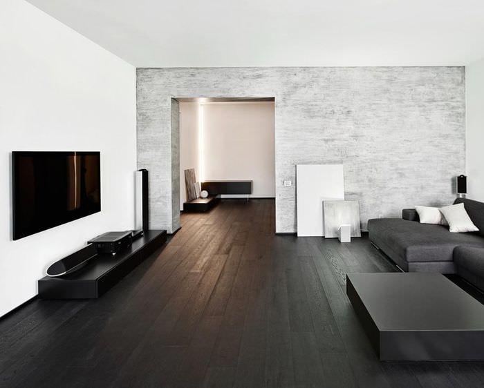 Темный пол из дерева в интерьере зала в стиле минимализма