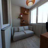 Небольшой диванчик серого цвета на застекленной лоджии