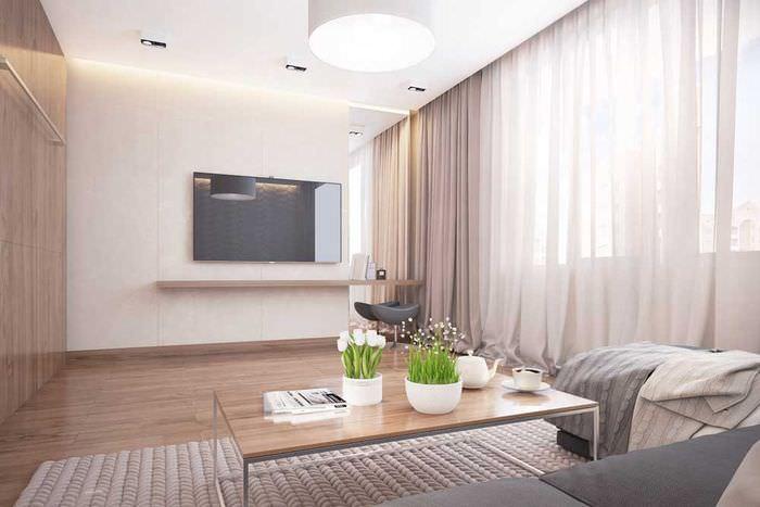 Легкие шторы до пола в интерьере гостиной площадью 14 квадратов