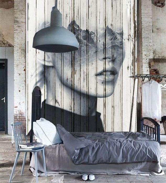 Изображение девушки над кроватью в комнате стиля лофт