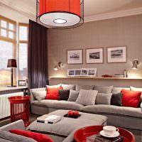 Сочетание красного и бежевого оттенков в интерьере гостиной