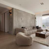 Серый бетон в интерьере гостиной