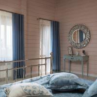 Синие шторы в спальне молодой девушки
